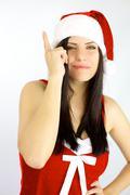 Stock Photo of female santa claus got a terrific idea for christmas