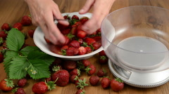 Washing and cleaning strawberries in small bowl Stock Footage