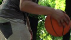 Man playing basketball on court in park, super slow motion, 240fps HD Stock Footage