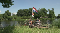 Old Dutch ferry with bicycles on board, canal Stock Footage