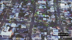 Aerial surveillance camera over suburbs Stock Footage