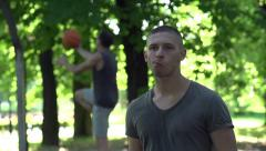 Man eating apple on baskeball court in park, super slow motion, 240fps HD Stock Footage
