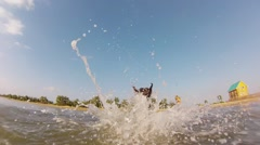 Doberman playing with toy in sea Stock Footage