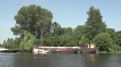 005Old Dutch houseboat in canal, landscape Stock Footage