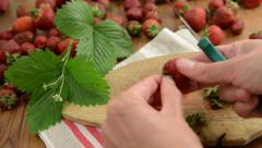 Cleaning strawberries Stock Footage