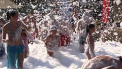 People Dance at Foam Day Beach Disco Music Party Stock Footage