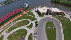 Aerial shot ascending from docked ship and museum - stock footage