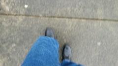 Male legs walking overhead shot Stock Footage