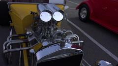 4K UHD custom built hot rod yellow chrome sleek walk around 1 - stock footage