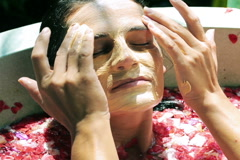 Woman putting mask on her face, relaxing in the spa  Stock Footage
