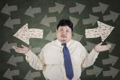 Stock Illustration of businessman doubt to choose a solution