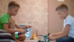 Two boys playing with constructor - stock footage