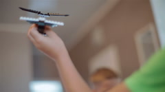 Small, talented boy playing with a toy airplane Stock Footage