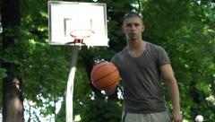 Portrait of serious basketball player on court in park HD Stock Footage