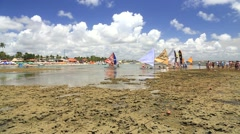 People enjoy a hot day in Porto de Galinhas, Recife, Pernambuco - Brazil Stock Footage