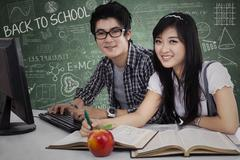 Cheerful young students in class  Stock Illustration