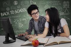 cheerful young students in class - stock illustration