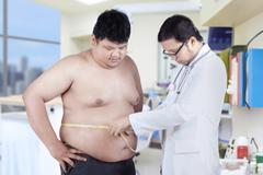 Doctor measuring a patient obesity Stock Photos