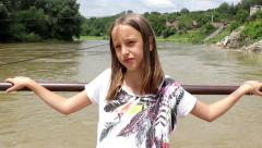 11. Young girl is transported by the old ferry across the big muddy river. Stock Footage