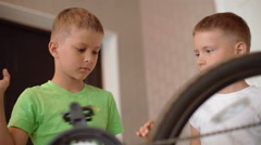 Two boys bike repaired and comfortable look to it Stock Footage