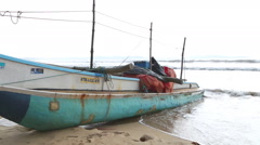 WELIGAMA, SRI LANKA - MARCH 2014: Boat on the beach in Weligama. Stock Footage