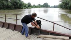 09. Ferryman transported people on the wooden ferry across the big muddy river. Stock Footage