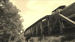 Old train is driving over a bridge Stock Footage