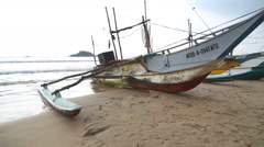 WELIGAMA, SRI LANKA - MARCH 2014: View of fishing boats on beach. Stock Footage