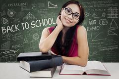 Stock Illustration of friendly female college student in class