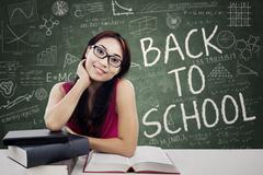 Friendly female college student in class Stock Illustration