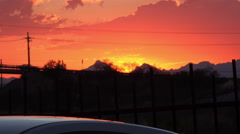 4K UHD orange skies sunset silhouettes cars mountains 2 Stock Footage
