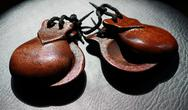Castanets On Black Leather Subsurface Stock Photos