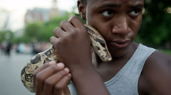 Handsome Black Youth with Large Boa Constrictor Pet Snake Stock Footage