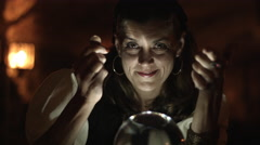 CU gypsy fortune teller beckons with coin 4K - stock footage