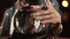 Tilt from crystal ball to fortune teller HD Stock Footage
