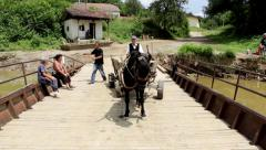 06. People and horse are transported by the ferry across the river. Ferryman. Stock Footage