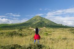 woman enjoying fresh mountain air - stock photo