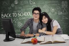 Young couple in class Stock Illustration