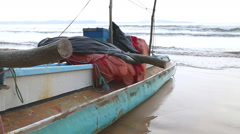 Traditional fishing boat on the beach in Weligama, Sri Lanka Stock Footage