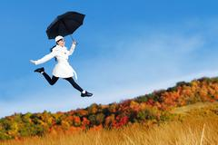 Young woman jumping with holding umbrella Stock Illustration