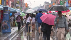 Toronto street festival in the summer on a rainy day Stock Footage