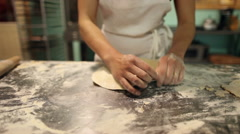 Baker making pie crust by hand Stock Footage