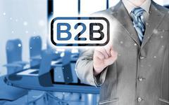 businessman pointing to word b2b - stock illustration