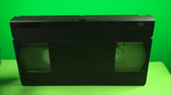Hand Opening The Latch From A Vintage VHS, Exposing Tape, On A Green Screen - stock footage