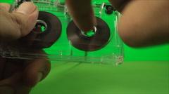 Hand Rewinding Vintage Audio Tape, On A Green Screen, Broken Cassette, Chroma Stock Footage