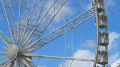 Ferris wheel turning around the axis from a low angle Stock Footage
