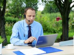 Male helpdesk  working with laptop in the  garden NTSC Stock Footage