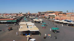 High-angle view of market stalls and people on Djemaa el Fna - stock footage