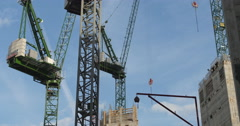 Man climbs down from large crane 4K Stock Footage