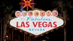 Welcome to Las Vegas sign at night neon rack focus - stock footage